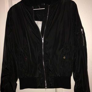 A black polyester jacket.